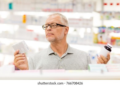 medicine, pharmaceutics, healthcare and people concept - senior male customer choosing between drugs at pharmacy