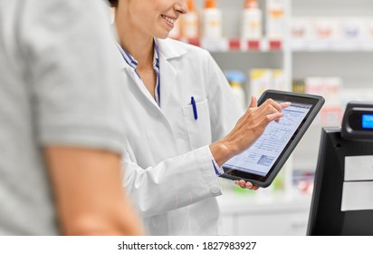 medicine, pharmaceutics, healthcare and technology concept - close up of smiling female pharmacist showing digital prescription on tablet pc computer to customer at pharmacy