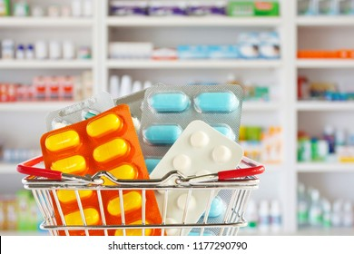 Medicine pill tablet in shopping basket with pharmacy drugstore shelves blurred background