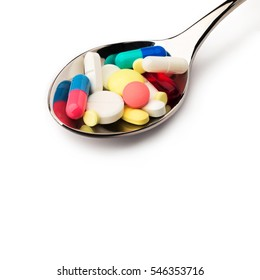 Medicine. A lot of pills into spoon