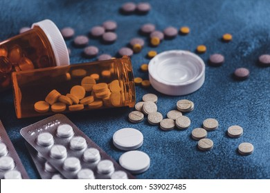 Medicine pills, tablets and capsules spilled from a bottle on table. Drug prescription for treatment medication. healthcare concept