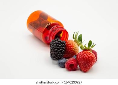 Medicine prescription bottle with fresh fruit spilling out