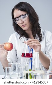 Medicine and Science Concepts and Ideas. Caucasian Female Researcher Investigating Organic Fruits in laboratory.