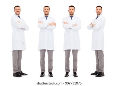medicine, science, profession and health care concept - happy doctors in white coat