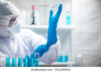 medicine specialist wearing PPE suit setting, medical people wearing surgical glove, face mask, and goggle to protection to work with coronavirus flu in hospital laboratory