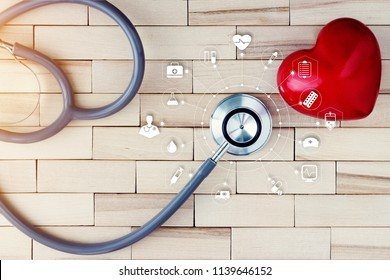 Medicine. Stethoscope with red heart and icon medical network connection on wooden. cardiovascular disease medical technology concept.