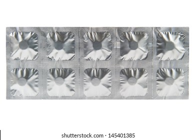 Medicine tablet in aluminum foil strip background
