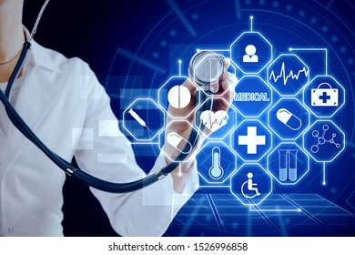 Medicine and tech concept. Doctor hand with stethoscope using creative glowing blue medical interface on dark background. Double exposure