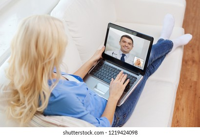 medicine, technology and healthcare concept - woman or patient having video call with doctor on laptop computer at home