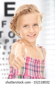 medicine and vision concept - girl with optical eye chart