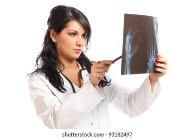 Medicine woman doctor looking at an x-ray