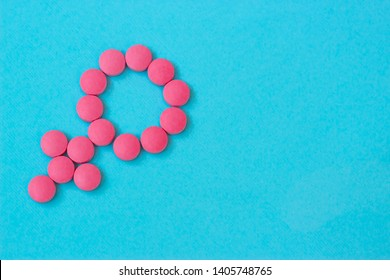 Medicine for woman. Menopause, pms, menstruation or estrogen concept. Female health. Gender symbol made from pills or tablets