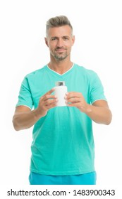 Medicines concept. Health is wealth. Bearded man holding vitamin pill container. Health pill. Mature man with pill bottle. Guy with medicine pill vitamin complex. Male health. Bio additives.