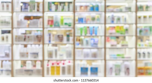 medicines healthcare product and cosmetics arranged on shelves in the pharmacy blurred defocused background