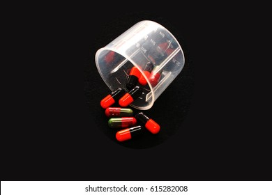medicines,drugs,tablets,isolate capsules on black background