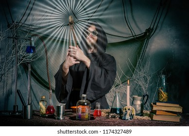 The medieval alchemist did the philosopher's stone. Scientist inventor steampunk works in his laboratory. Science fiction concept. Halloween.
