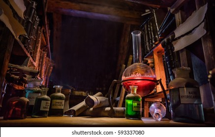 Medieval alchemist laboratory with various kind of flasks and old books in Prague, czech republic