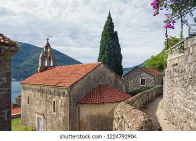Medieval architecture. Montenegro. View of ancient town of Perast. Temple of the Nativity of the Virgin Mary