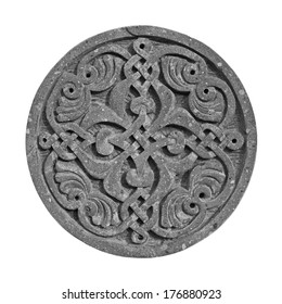 Medieval armenian ornament on cross-stone isolated on white