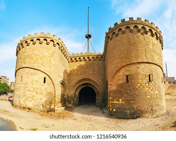 The medieval Bab Al-Azab Gate of Saladin Citadel with modest stone decors and crack along the right tower, Cairo, Egypt.