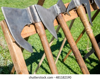 medieval battle axes aligned in rack