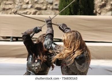 Medieval battle with swords between women
