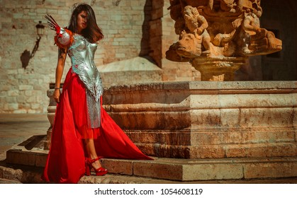 Medieval, Beautiful brunette woman wearing gold and copper corset in goddess and warrior poses. fantasy and imagination concept