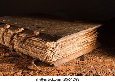 Medieval book of more than 300 years old with a wooden cover on a grungy table