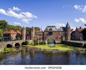 Medieval brick city gate the 'Koppelpoort' in Amersfoort, Holland, spans the river Eem