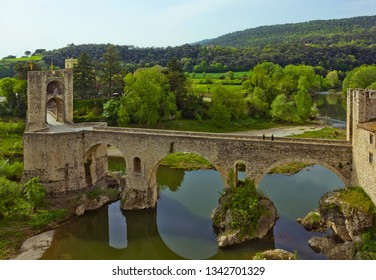 Medieval bridge with gate and river in Girona province in Besalu, Catalonia, Spain