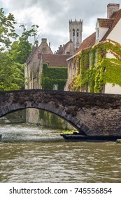 Medieval bridge over a canal in Bruges, Belgium