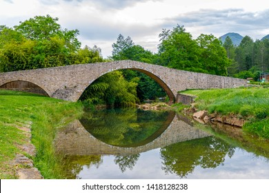 Medieval bridge over the Rialsesse river in Serres, France, located in the Aude department and the Languedoc Roussillon region.