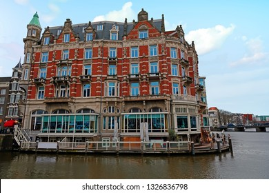 Medieval building along the river Amstel in Amsterdam Netherlands