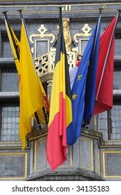 Medieval building on Grand place with flags in Tournai - small city in Belgium