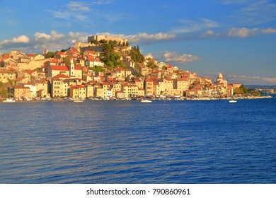 Medieval buildings on a hillside above the Adriatic sea shore, Sibenik, Croatia