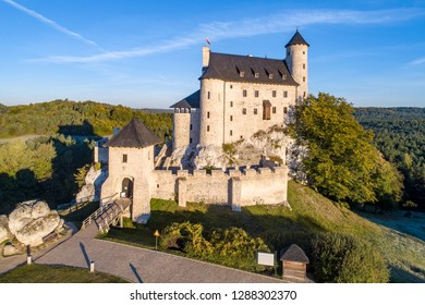 Medieval Castle in Bobolice, Poland, built in 14th century, renovated in 20th century. One of strongholds called Eagles Nests in Polish Jurassic Highland in Silesia. Aerial view in sunrise light