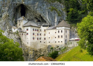 The medieval castle called Castel Lueghi in the Slovenian grad Predjama, is a Slovenian castle whose construction dates back to the 13th century. It is located in the territory of Postojna, Slovenia