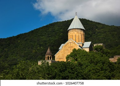 Medieval castle complex with church on Jinvali water reservoir, Aragvi river, Ananuri, Georgia