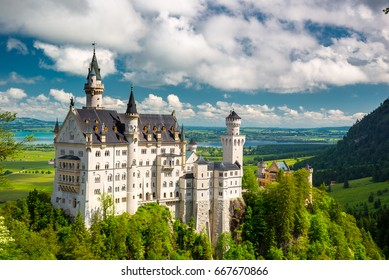 Medieval castle Neuschwanstein. Around the blue sky and the Alps. Beautiful view of the castle. Open landmark and background nature.