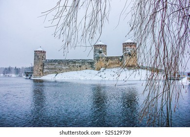 Medieval castle Olavinlinna  in the city of Savonlinna  during the heawy snow storm. Finland.