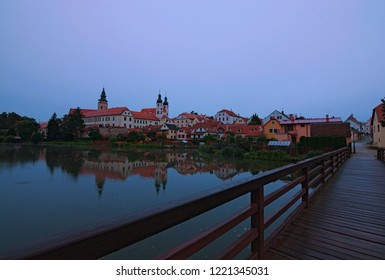 Medieval castle and old town with beautiful mirror reflections on smooth lake water. Summer landscape. A UNESCO world heritage site. Telc, Czech Republic.