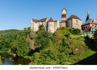 The medieval castle on a prominent rock promontory, surrounded on three sides by the Ohře River, is the heart of the picturesque town Loket in the western part of the Czech Republic - Europe