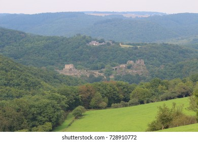 medieval castle ruin on a hill in a valley