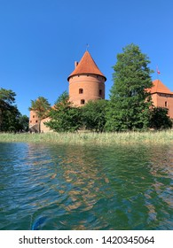 Medieval castle in Trakai, Lithuania. Trakai Castle on the island in the middle of the lake. Scenic view of castle from lake side