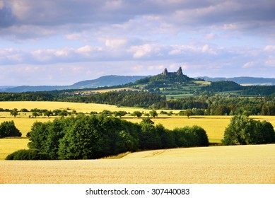 Medieval castle of Trosky and surrounding summer time landscape
