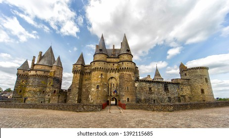 Medieval castle of Vitre city in Brittany (France). View of towers and main entrance gatehouse and facade of the medieval castle Chateau.