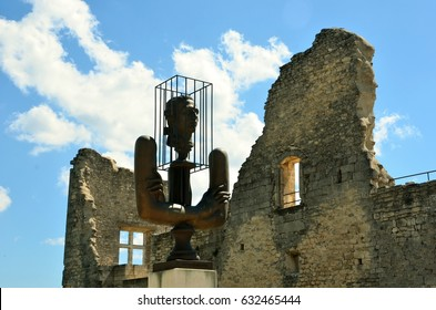 Medieval castle walls with bronze bust of Marquis De sade in Provence - Lacoste