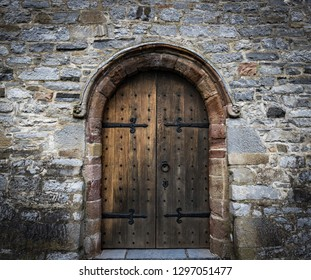 medieval castle wooden door, and stone wall background