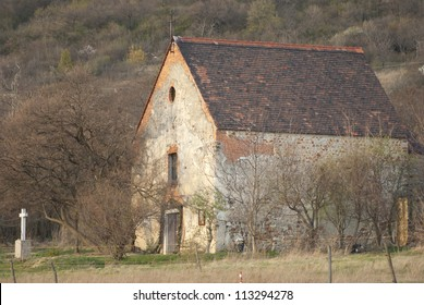 medieval catholic chapel on a hill at fall