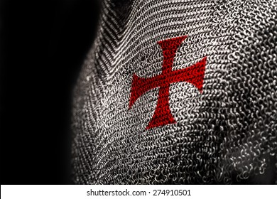 Medieval chainmail armour with a red cross on chest area